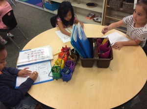 Kinder writing witih supports